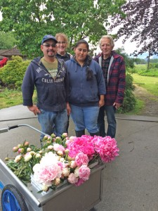 The Pure Peonies team includes (from left) José Jacabo, co-owner Renel Anderson, Jessica Salazar-Jacabo, and co-owner Jim Wright. Visitors will see 190 varieties of peonies at the farm's display garden. PHOTOS BY MARY VERMILLION
