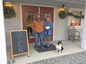 Roger and Suzanne Wecshler, and Charley the Cheese Dog, of Samish Bay Cheese welcome visitors to their new cheese shop and production facility on Bow Hill Road. Deli cases in the creamery's new retail shop showcase their cheese. PHOTOS BY MARY VERMILLION