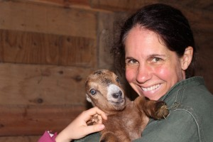 The author, Corina Sahlin, and a baby goat.