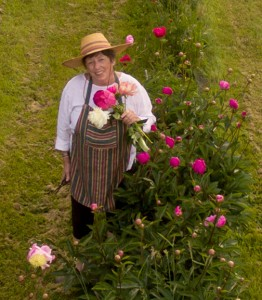 Elisabeth Marshall in her peony field, and an overview of Full Bloom Farm on Lummi Island (below). Marshall has a self-serve farm stand on site (below). COURTESY PHOTOS