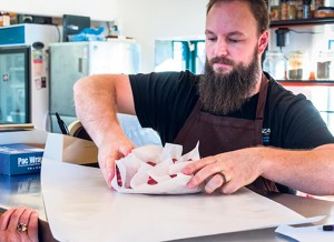 Owner Shaun Almassy wraps orders at Carne, 1205 Washington Street in Bellingham. PHOTOS BY DAVID JOHNSON