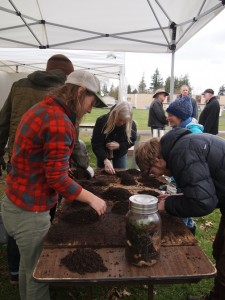 Attendees are welcome to get their hands dirty during the demonstrations. Free soil tests and free tarps are available for qualifying farmers. COURTESY PHOTO